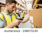 warehouse worker scanning... | Shutterstock . vector #248073130