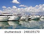 Row Of Luxury Yachts Mooring I...