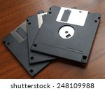 three floppy disk on wood table ... | Shutterstock . vector #248109988