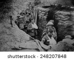 Small photo of Bandaged British World War 1 soldiers in a battlefield trench, 1915-1918.