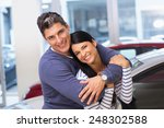 happy couple smiling at camera... | Shutterstock . vector #248302588