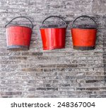 The Old Red Metal Buckets For...
