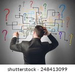 businessman trying to solve a... | Shutterstock . vector #248413099
