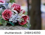 Silk Flowers On A Gravestone ...