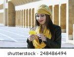 beautiful brunette girl looks... | Shutterstock . vector #248486494