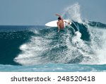 A Surfer Carves A Radical Off...