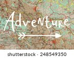 Small photo of Adventure written on blurred map