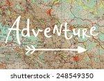 Adventure Written On Blurred Map