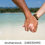 man and woman holding hands on... | Shutterstock . vector #248550490