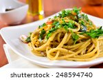 plate of spaghetti with porcini ... | Shutterstock . vector #248594740