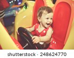 Happy Child Smiling In Toy Car...