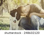 Stock photo man with his dog playing in the park 248632120