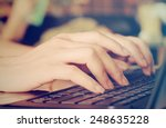 female hands typing on laptop... | Shutterstock . vector #248635228
