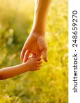 a parent holds the hand of a... | Shutterstock . vector #248659270