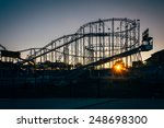 Sunset And Rollercoaster In...