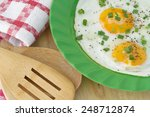 fried eggs in green plate