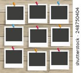 9 photo frames on the wooden... | Shutterstock .eps vector #248750404