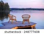 two chairs on dock with glasses ... | Shutterstock . vector #248777608