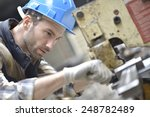 Industrial Worker Working On...