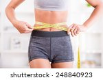 Sporty Woman And Measure Around ...