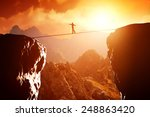 man walking and balancing on... | Shutterstock . vector #248863420