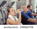 Young Woman Drinking Bottled...