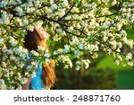Young Woman In Spring Orchard