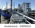 oil worker in foreground... | Shutterstock . vector #24890614