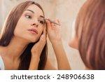 tweezing eyebrows. beautiful... | Shutterstock . vector #248906638
