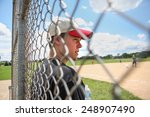 Teen Boy On Sidelines At...