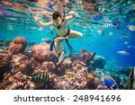 snorkeler diving along the... | Shutterstock . vector #248941696