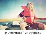 Boy Rowing A Boat On A Lake. ...