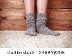 legs of a woman in gray socks... | Shutterstock . vector #248949208