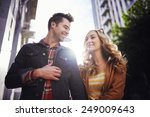 romantic couple walking through ... | Shutterstock . vector #249009643