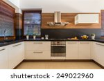 Stock photo horizontal view of modern furniture in luxury kitchen 249022960