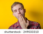 tired man covering his mouth... | Shutterstock . vector #249033310