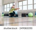 senior woman doing exercise... | Shutterstock . vector #249083350