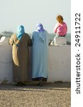 woman standing on a essaouira... | Shutterstock . vector #24911722
