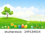 Vector illustration of a beautiful Easter scenic background with decorated eggs in the grass