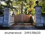 Stone Wall And Wooden Gateway...