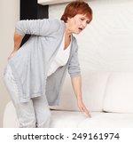 adult woman has a backache.... | Shutterstock . vector #249161974