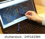 Small photo of designer working on a cad blueprint