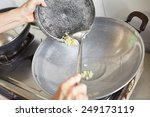 stir frying the crushed garlic... | Shutterstock . vector #249173119