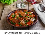beef stew with peas and carrots | Shutterstock . vector #249261013