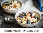 oatmeal with berries and nuts | Shutterstock . vector #249309910