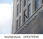 a worker is washing the...   Shutterstock . vector #249379540