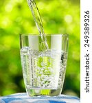 glass of water on nature...   Shutterstock . vector #249389326