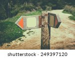 signpost in countryside... | Shutterstock . vector #249397120