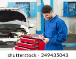 mechanic writing on a clipboard ... | Shutterstock . vector #249435043