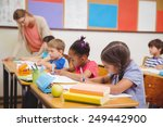 cute pupils drawing at their... | Shutterstock . vector #249442900